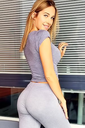 Blonde hottie Maria Doroshina posing in yoga pants and workout shorts
