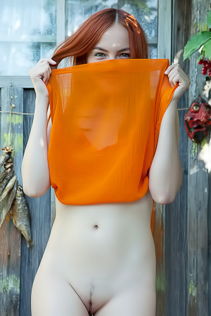 Sexy redhead Shaya lets her bright orange dress slip down to bare her gorgeous breasts