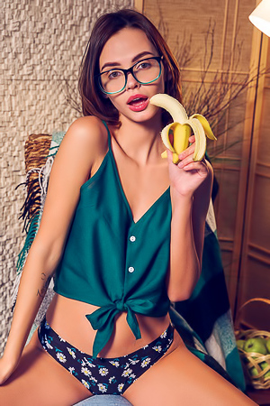 Gorgeous Brunette Lilit A Looks Cute In Her Glasses, Her Top Tied Up To Expose Her Sexy Tanned Midriff picture gallery